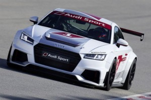 "Audi have announced the release of a racing version of the TT, dubbed the 'TT Cup', which will take part in a championship of the same name in 2015, supporting the DTM (German Touring Cars), across six rounds. The track-ready TT Cup will feature a 2.0-litre turbocharged engine packing 306bhp and mated to a six-speed DSG gearbox – which have both been carried across largely unchanged from the road legal TT S. However in its stripped-out racing state the TT Cup weighs just 1,125kg – considerably less than the road car's 1,460kg kerb weight. Additionally, a 'push-to-pass' function has been added and unleashed another 30bhp, which combined with the weight saving should noticeably liven up the car. A total of 24 TT Cups will be prepared for each round, with the grid comprising six 'changing guest drivers' and 18 private racers. When asked about the new track-ready TT Cup, Audi's research and design chief Dr Ulrich Hackenberg said: ""For me it was clear that a driving machine like the new Audi TT belongs on the race track as well...The TT is going to thrill fans and drivers"". News of this dedicated track edition of the TT has led to a lot of speculation online, with many Audi fans asking if a similar road legal version of the Cup will be made available to the general public. Judging by the reaction of Audi fan boys and guys alike, we don't doubt that there would be a significant level of interest in a stripped-out, lightweight TT – should the company decide to build one."