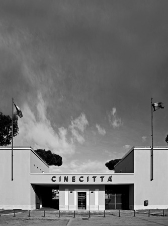 "NOVEMBER 19TH, 2015 THE MÉTIERS D'ART 2015/16 SHOW AT CINECITTÀ THE MÉTIERS D'ART 2015/16 SHOW AT CINECITTÀ Cinecittà, the city of cinema – built in just eighteen months prior to its grand inauguration in 1937 – houses twenty-one studios over nearly sixty hectares, with five giant film sets and a special pool for ocean scenes and naval battles. Three hundred films were shot there in its first six years, but the studios really took off in the 1950s when Mervyn LeRoy filmed his epic ""Quo Vadis"" there. Cinecittà became known as Hollywood on the Tiber as its low running costs drew major American film productions in increasing numbers: 150 epics were shot there over the following fifteen years, including ""Ben Hur"", ""Spartacus"", and ""Cleopatra"". Federico Fellini once said his favourite place in the whole world was Cinecittà's Studio 5, where he shot a series of major works from ""La Dolce Vita"" and ""8 1/2"" to ""Casanova"" and ""Ginger and Fred"", including ""Intervista"", a homage to the studios. Cinecittà was also home to such masterpieces as Vittorio De Sica's ""Bicycle Thief"", William Wyler's ""Roman Holiday"", and Luchino Visconti's ""The Leopard"". The sets are still used for many of the world's leading film productions to this day, from Anthony Minghella's ""English Patient"" to Ridley Scott's ""Gladiator"" and Martin Scorcese's ""Gangs of New York"". Cinecittà has been chosen to host Karl Lagerfeld's Métiers d'Art 2015/16 show on December 1st."