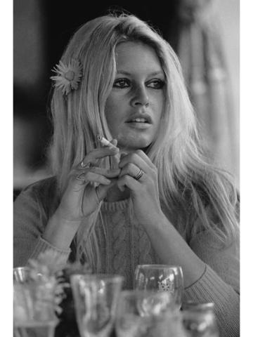 French actress Brigitte Bardot with a flower in her hair on the set of 'Shalako', directed by Edward Dmytryk, 1968. (Photo by Terry O'Neill/Hulton Archive/Getty Images)