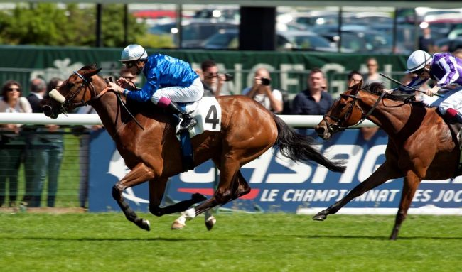 Beauty Parlour (Christophe Soumillon) beats Up (Joseph O'Brien) to win the Poule D'Essai des Pouliches Longchamp 13.5.12 Pic:Edward Whitaker