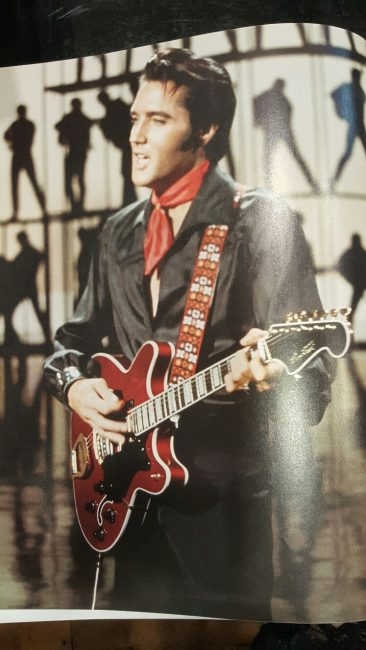 Rock star Elvis Presley & his guitar with strap